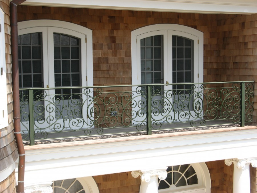 Hand forged stair railing with brass cap rail and initials for French balcony railing