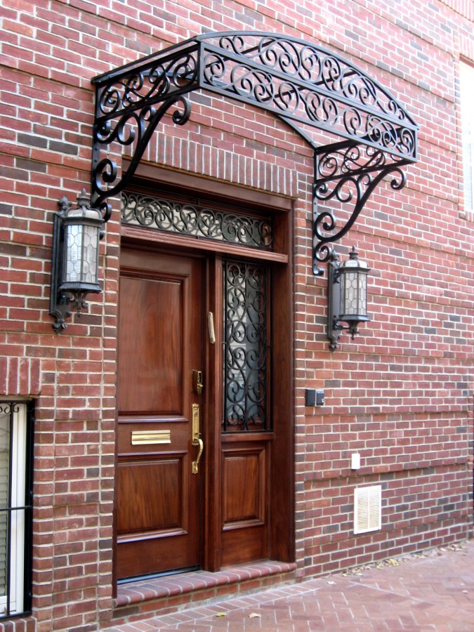 Custom Wrought Iron Glass Canopy And Matching Transom Window Grilles